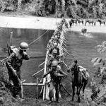 Merrill's Marauder's cross a river in Burma (now Myanmar) in 1944. U.S. Army photo.